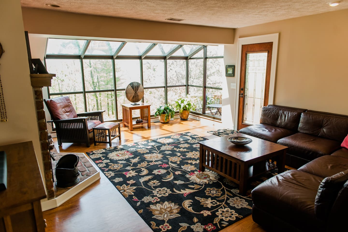 Living area with floor to ceiling windows with view to the river!