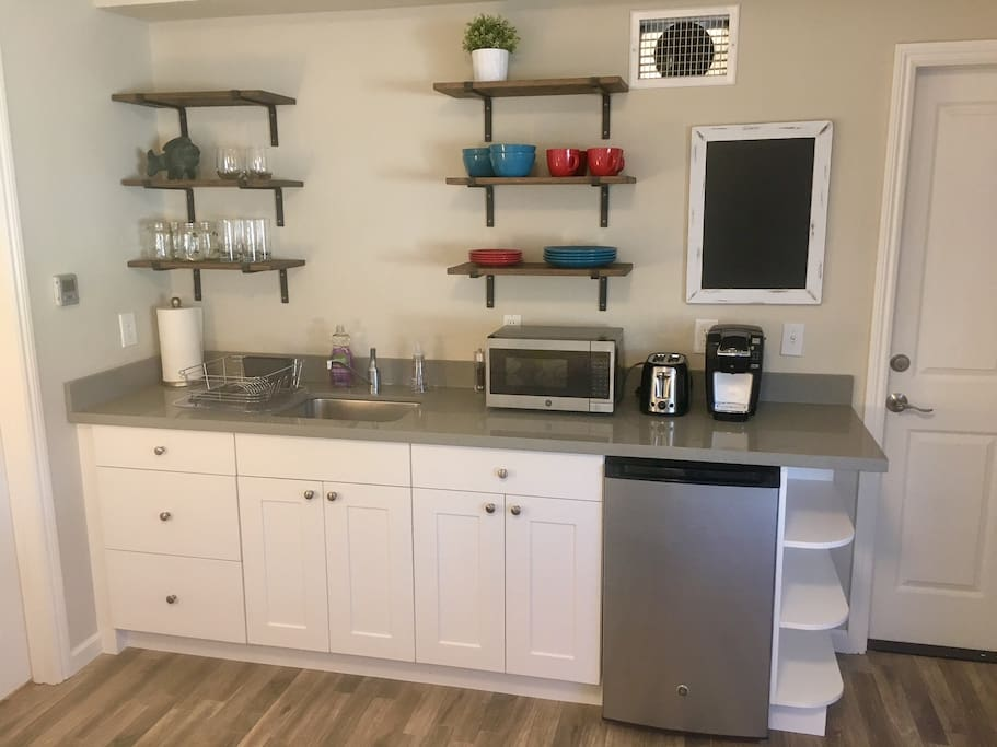 Kitchenette with mini fridge, microwave, Keurig coffee machine, and toaster