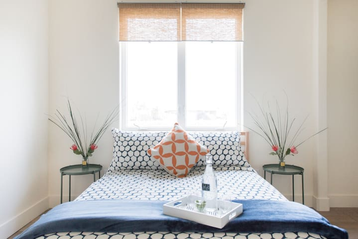 Get your needed rest and relaxation. This bedroom has two double beds. Views look out to the artichoke fields.