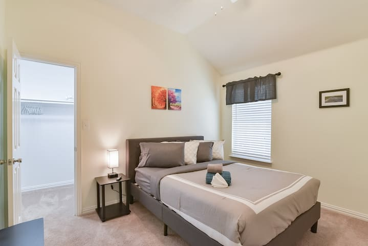 Secondary Bedroom with more space than you will need to relax and kick your feet back.