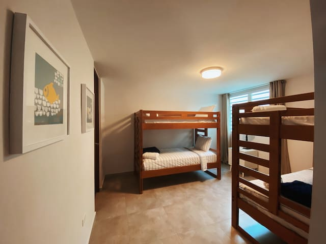 3rd bedroom have two bunker beds and a standalone full bathroom nearby.