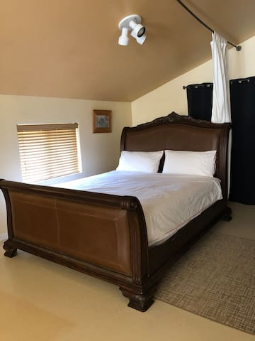 Cozy New California king bed and mattress for your sleeping comfort!