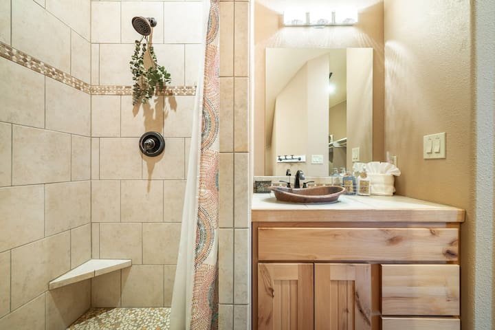 This home is 2.5 baths. This is a picture of the Master bath with a spacious shower as well as his & her sinks.