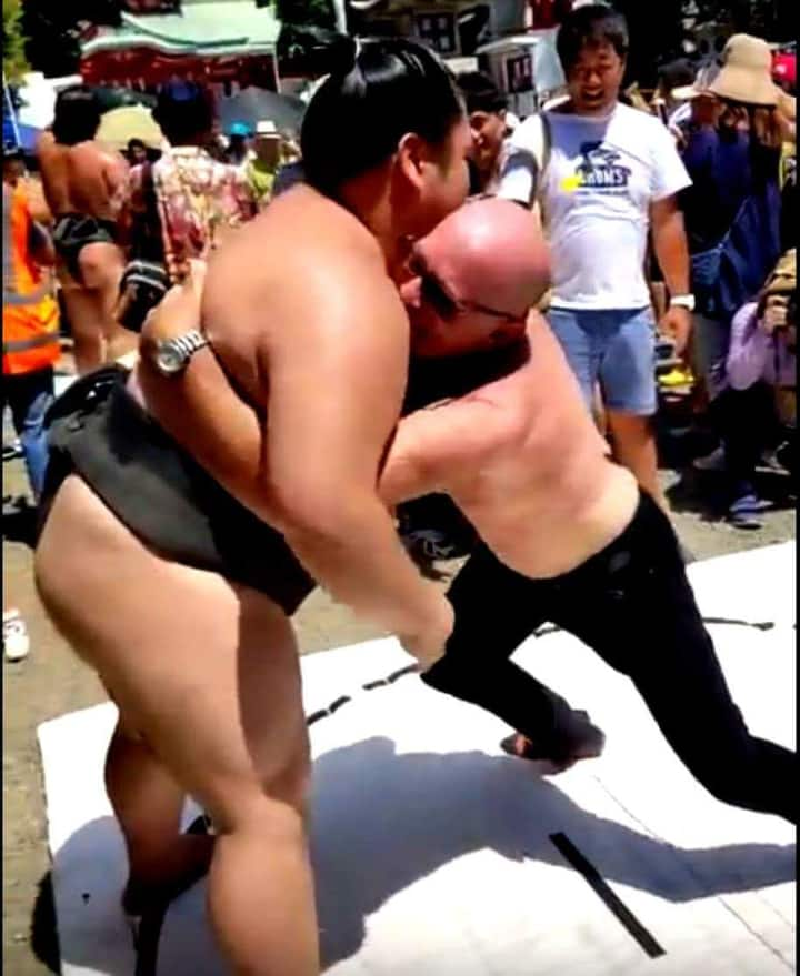 "Your Guide ""Me"" wrestling Rikishi"