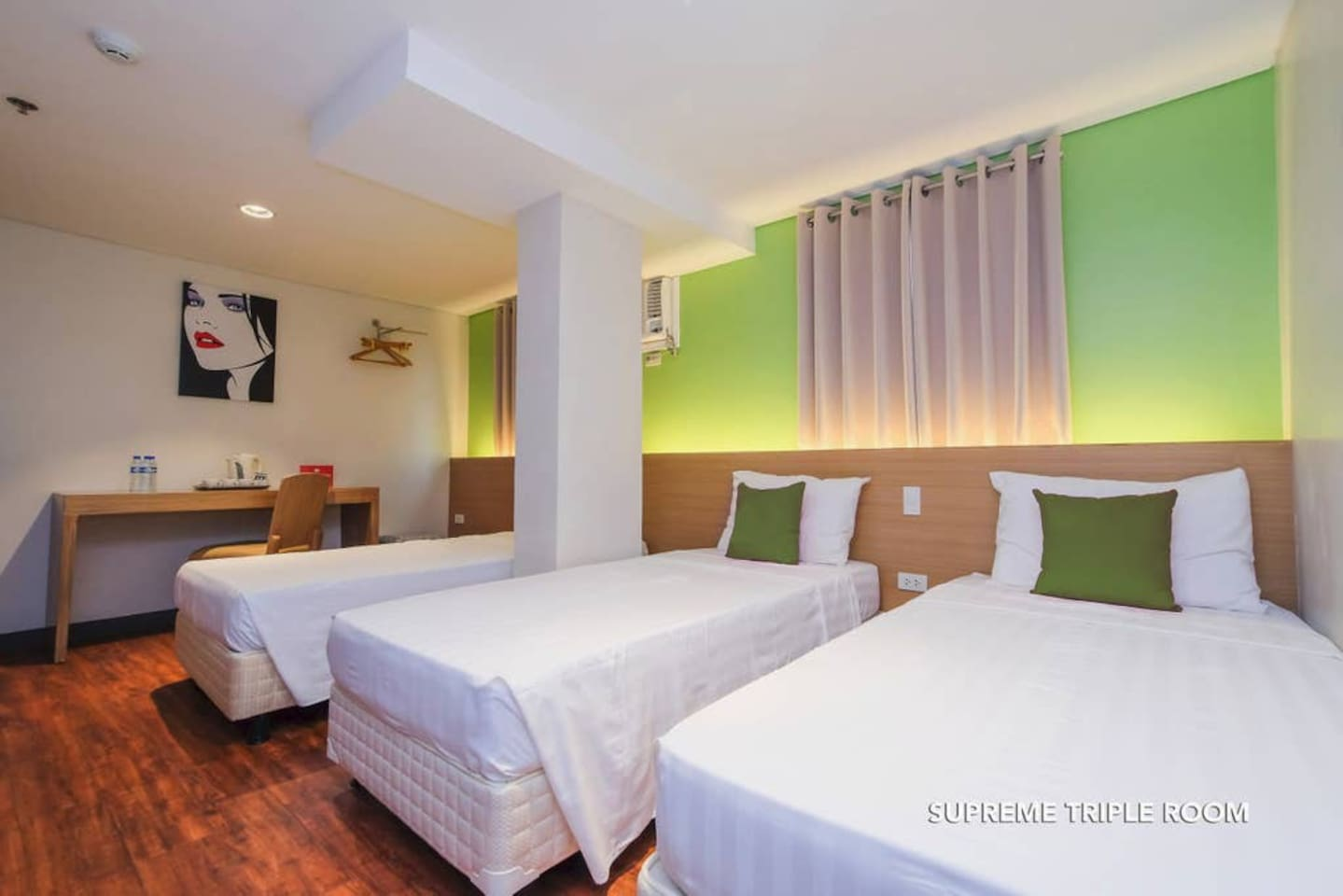 Interior of Supreme Triple bedroom at MySpace Hotel @BGC with bottle of water and electric kettle