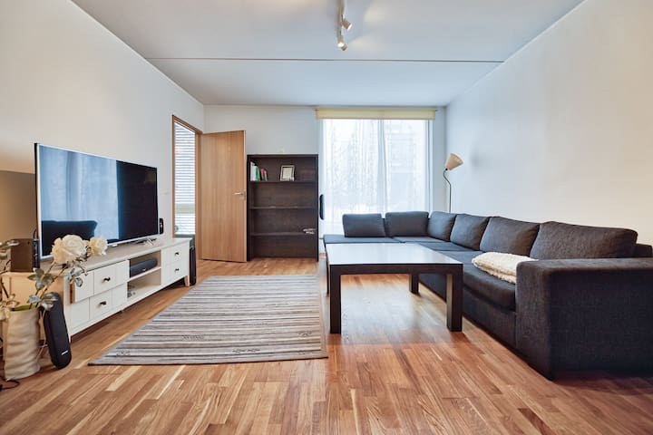 Spacious living room with 55'' TV