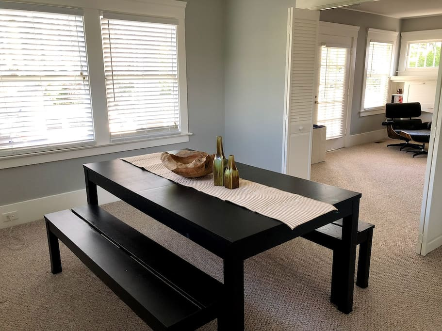 Dining room with natural light, dining table seats 6 - perfect for family & friend gatherings! Highchair and additional chair available as needed
