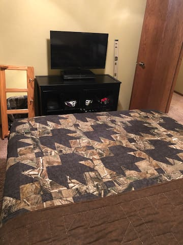 Second Bedroom with TV and Queen Bed