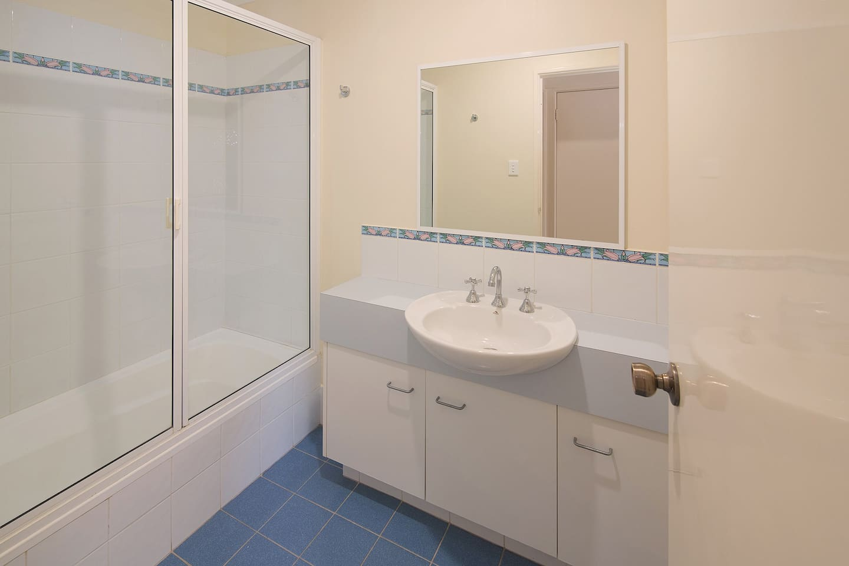 The main bathroom has a bath and shower.