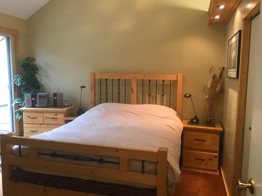Master Bedroom with queen bed and private deck