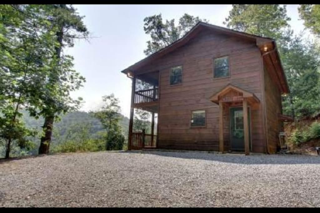 Beautiful cabin nestled on a hillside with two decks. Top deck is screened in for comfort.