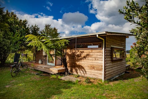 unique water's edge cabin on  Mangawhai harbour