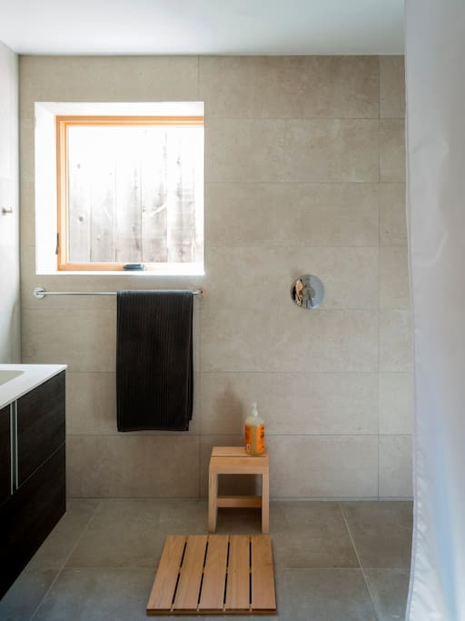 Spa-like tiled bathroom with curbless shower.