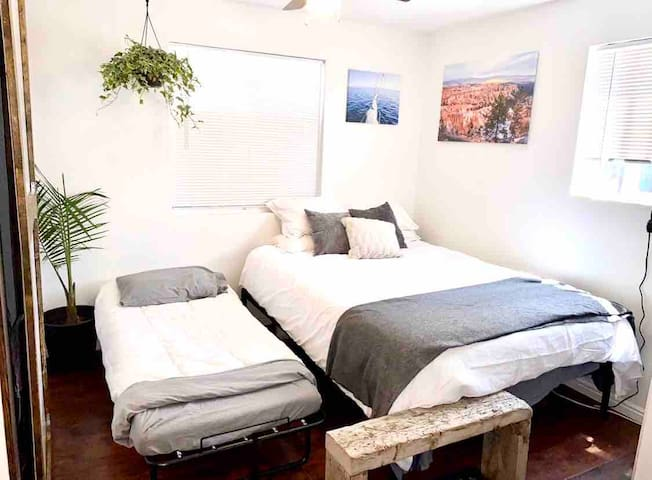 Comfy queen bed and rollaway! Everything's easy to move so feel free to make the place how ever works for you!