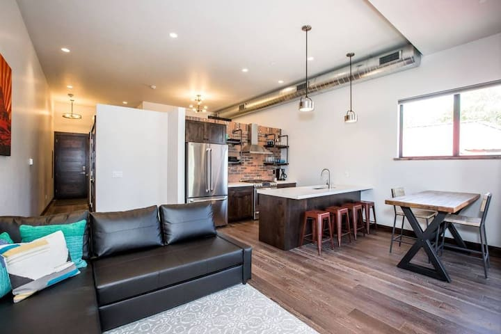 Spacious, clean and comfortable main room with plenty of space for 4 people and a big screen TV. Dining table and bar seating. Couch pulls out to full-sized bed. Now updated with additional seating and local artwork.