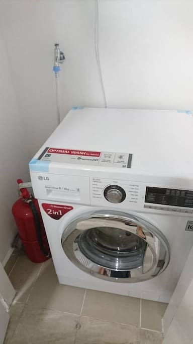 laundry machine, fire extinguisher included.
