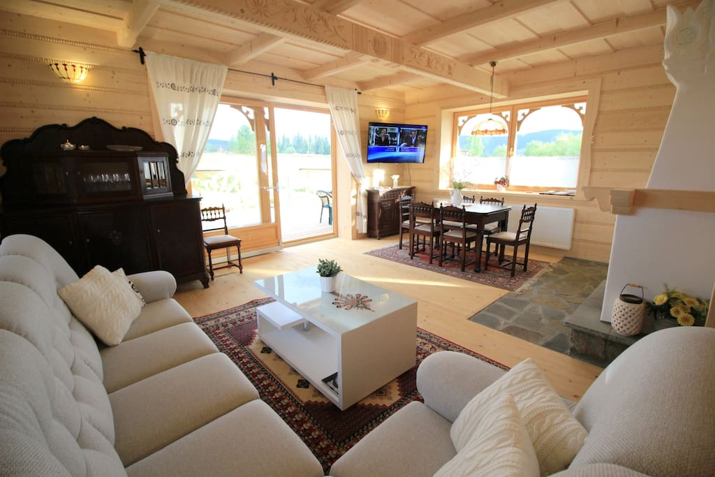 Seating area, living room, fireplace, dining area. Sundeck outside