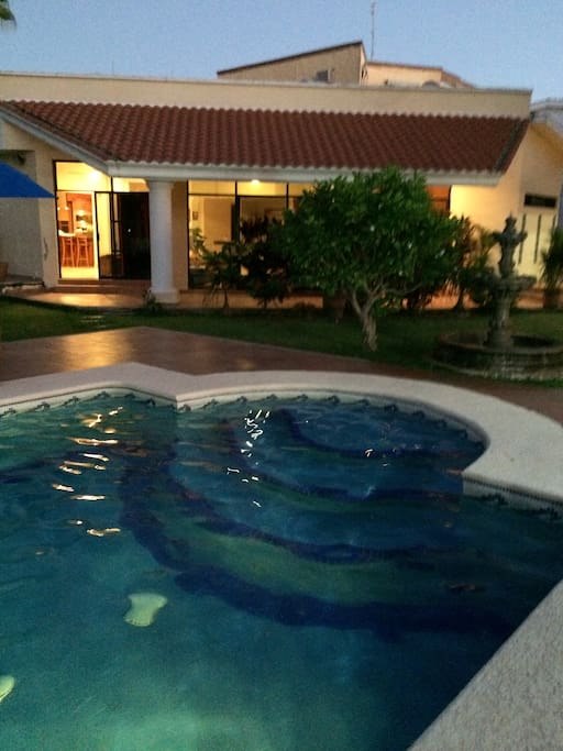 Luxurious pool lit up in evening.