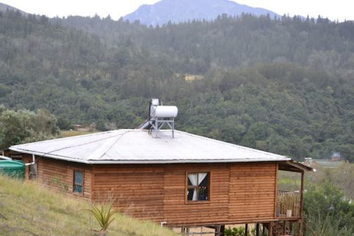 Wooden cottage. Two bedrooms with 1.5 bathroom and open living/kitchen area. Sleep 8