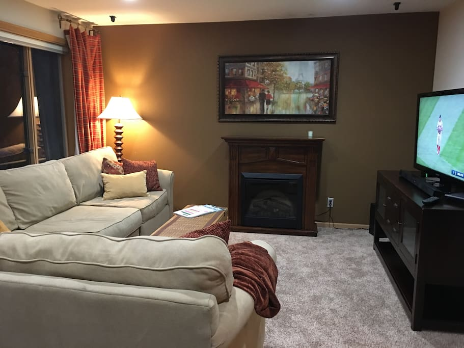 Cozy living area with fireplace (electric), LED TV/Blu Ray and views to the garden