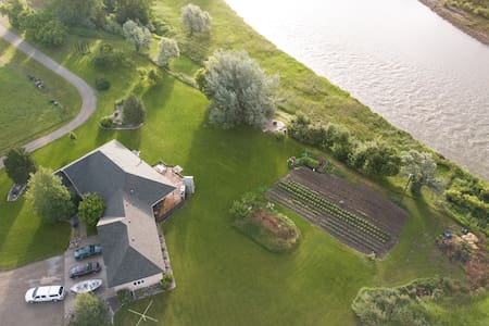 QUIET COUNTRY LIVING AT RIVER'S EDGE