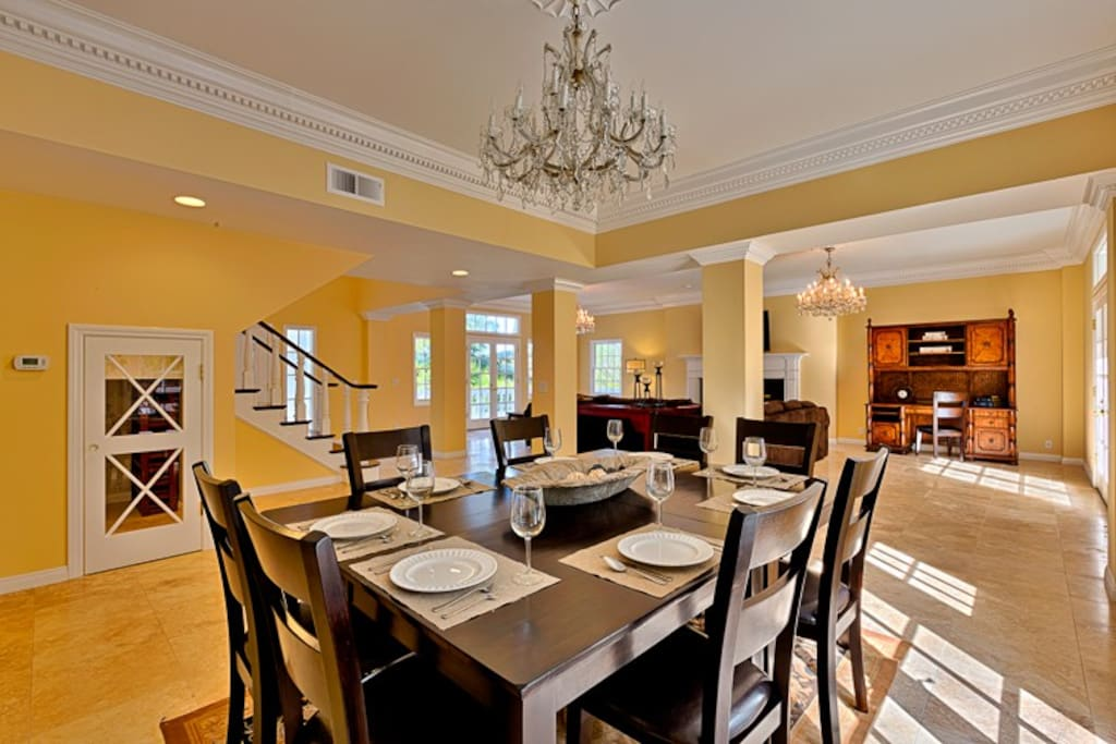 The Dining Area features a gorgeous crystal chandelier, wine cellar, wet bar with wine refrigerator, and seating for 8.
