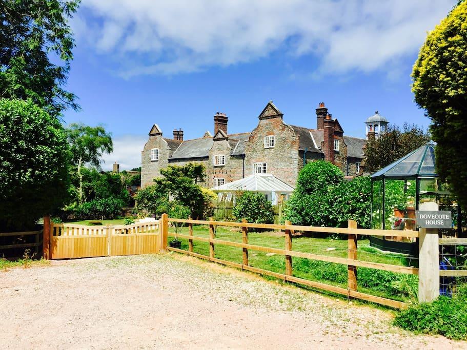 Dovecote House, set in 1 acre of South-facing garden.
