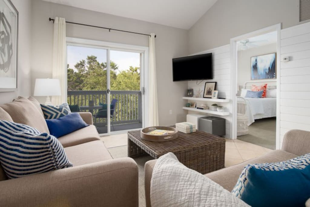 Enjoy the bright and open living area, featuring vaulted ceilings for a spacious feel!