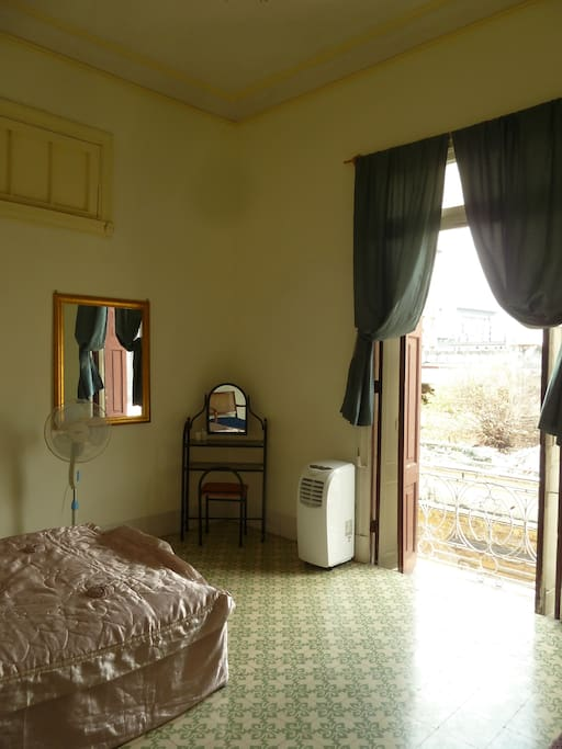 Room with balcony no. 1. One double Bed and one single bed. Very comfortable because of the amplitud, with a balcony that leave the breeze get in to the Room. With fan and modern air cond. Bathroom IS share with the next balcony Room.