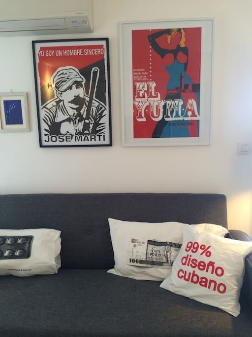 The sofa bed with pillows and art creations of the cuban brand Clandestina.