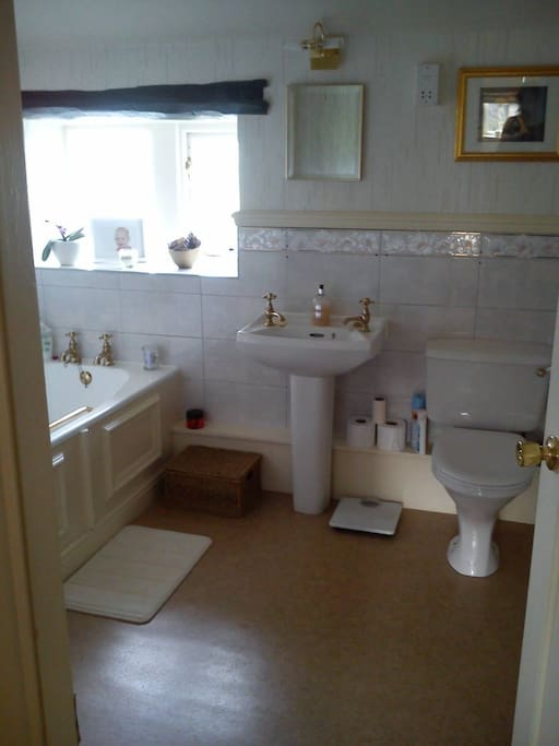Private bathroom  has a large bath and separate shower unit