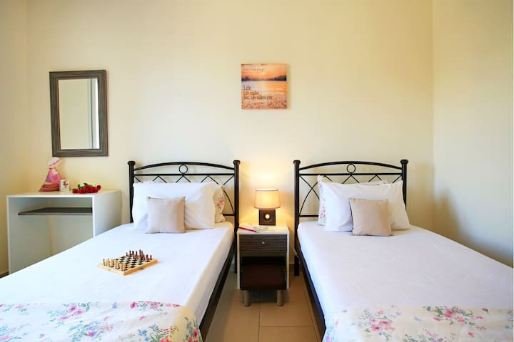 Your third bedroom at the upper floor with two single beds and air condition.