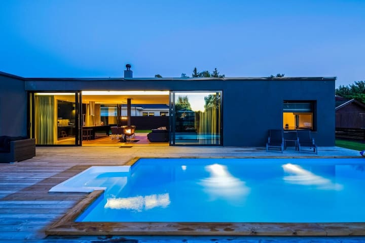 Design house in Skälby with heated pool