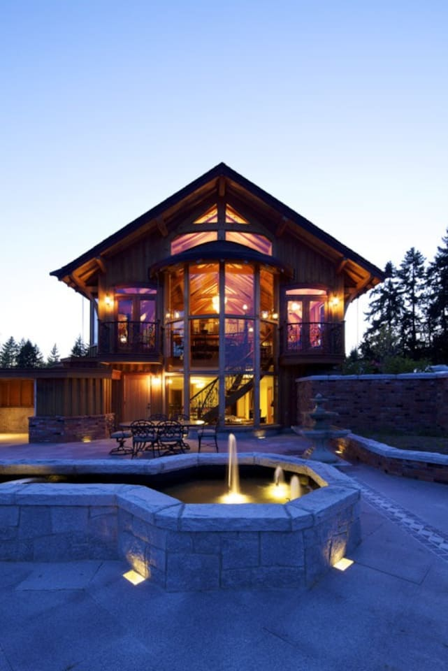 A True Viking Long House, Hidden Away in the Heart of Vancouver Island This one of a kind luxurious timber frame house was built by Pat Woodland in 2010, a boat builder by trade and very much navel inspired.   The house was built without the use of a single nail. Craig Barnes, mortise and tenon Oak into Douglas Fir (both native island woods). The dazzling eyebrow dormers and roof trusses arches were curved by hand with steamers.