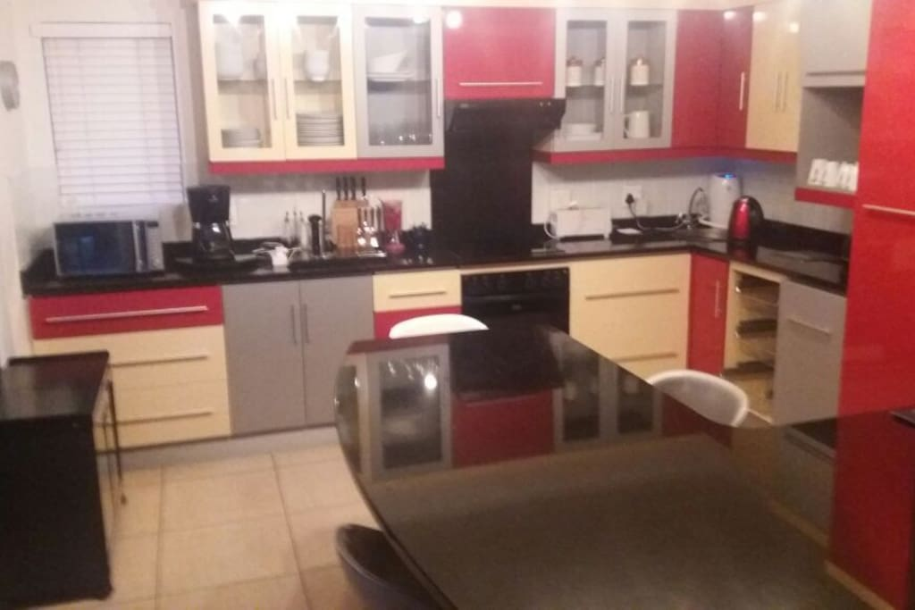 Fully equipped kitchen with open plan lounge