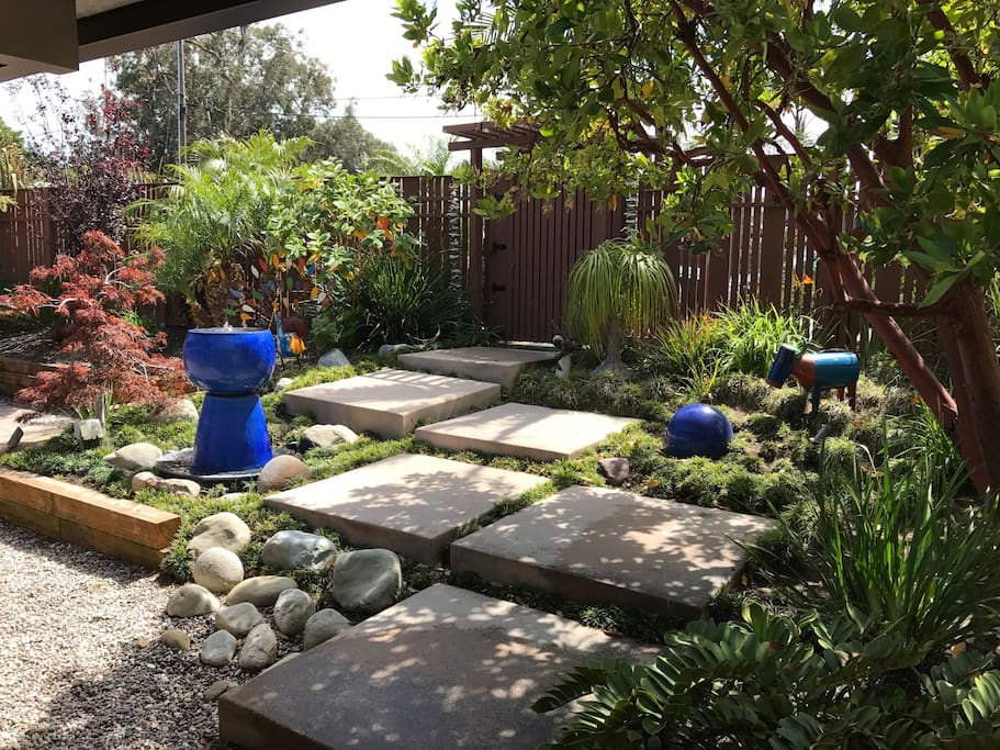Serene Front Entry Area with Fountain and Hummingbirds