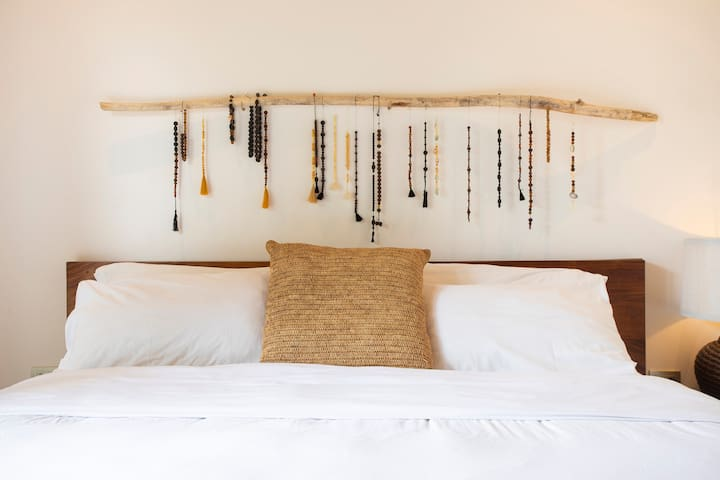 Master Bedroom with hand made art piece.
