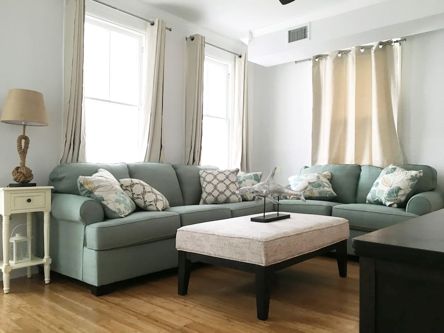 Beautifully decorated living room with comfortable couches for you to relax