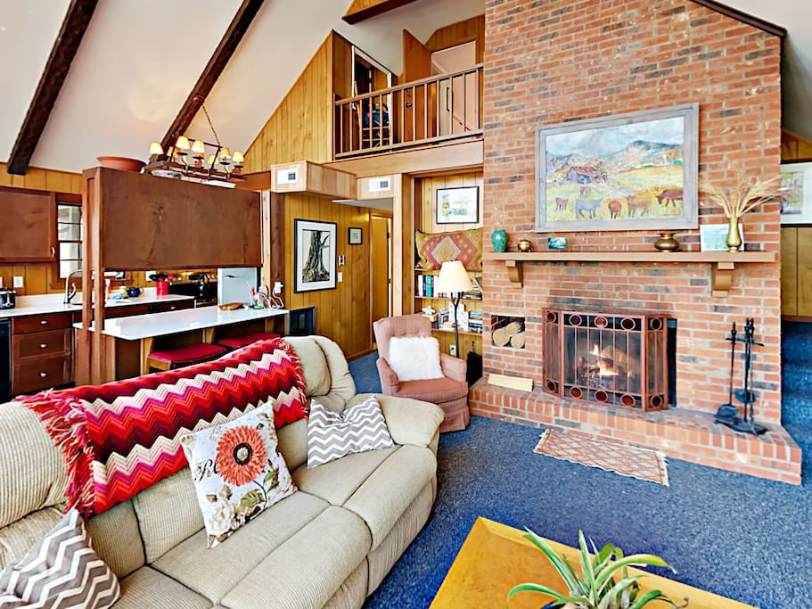 Enjoy the warm ambiance of the wood-burning fireplace in the living room.