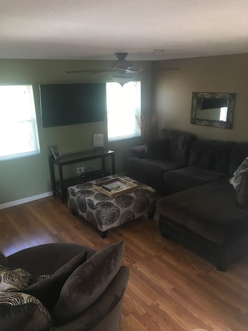 Living room with very comfortable sectional and swivel chair
