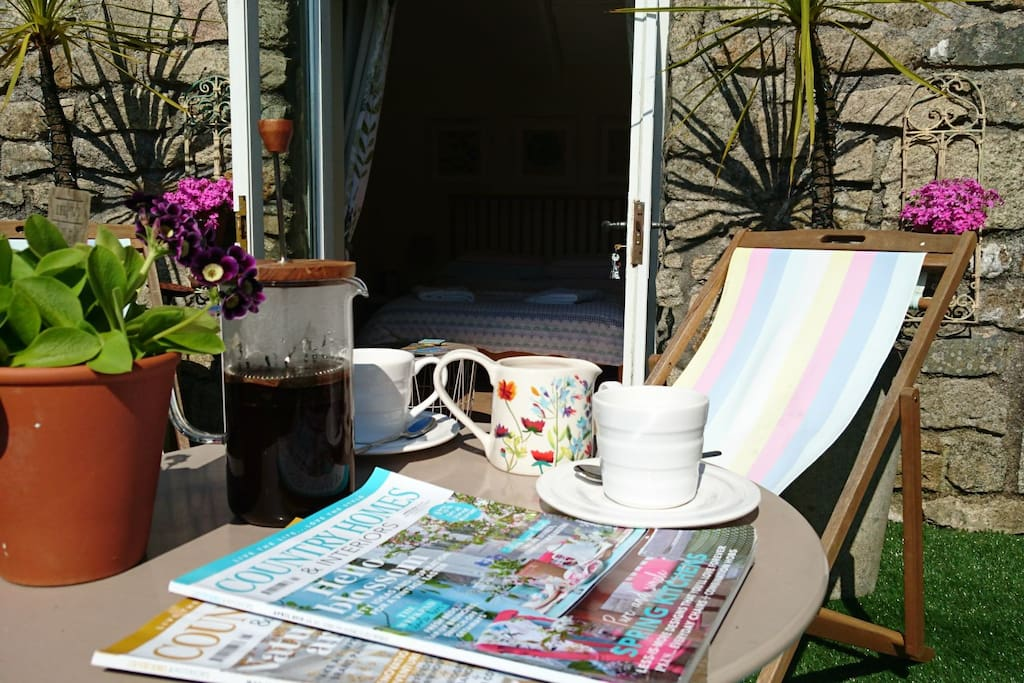 Why not enjoy morning coffee outside.  Fresh flowers on arrival outside from the garden in the summer.