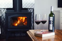 Fire, wine, views.....What more could you need. Relax by the fire with a book and glass of wine grown on the property.
