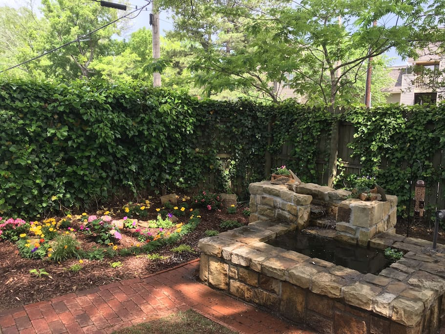 Private fenced yard with fountain & fire pit