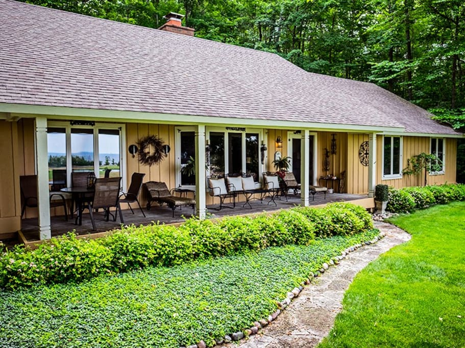 Front of Home with Plenty of Outdoor Seating to Take in the Views