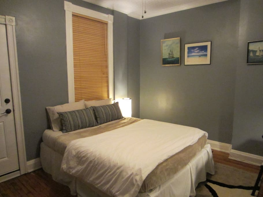 Your private room with a memory foam queen bed, desk, dresser, TV, closet, and private balcony.