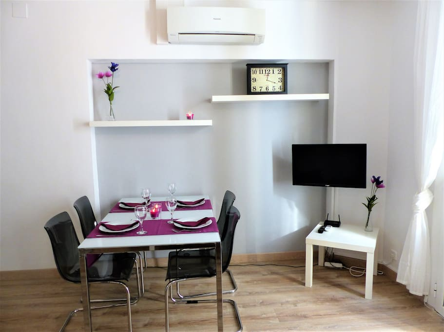 Air-conditioned dining-living room with TV and balcony