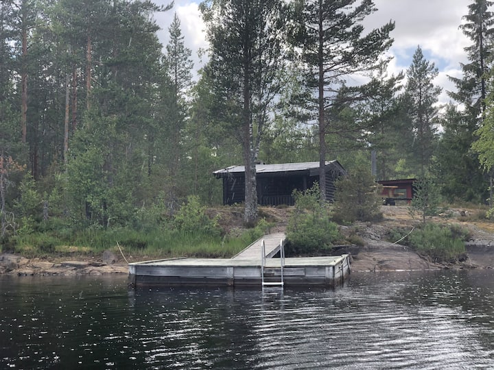 Nice timber hut in lake - private pier