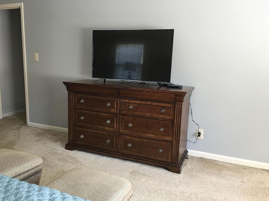 """Master bedroom #1 with a 49"""" flat TV"""