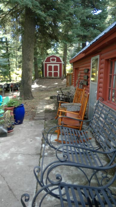 Porch with giant rockers.