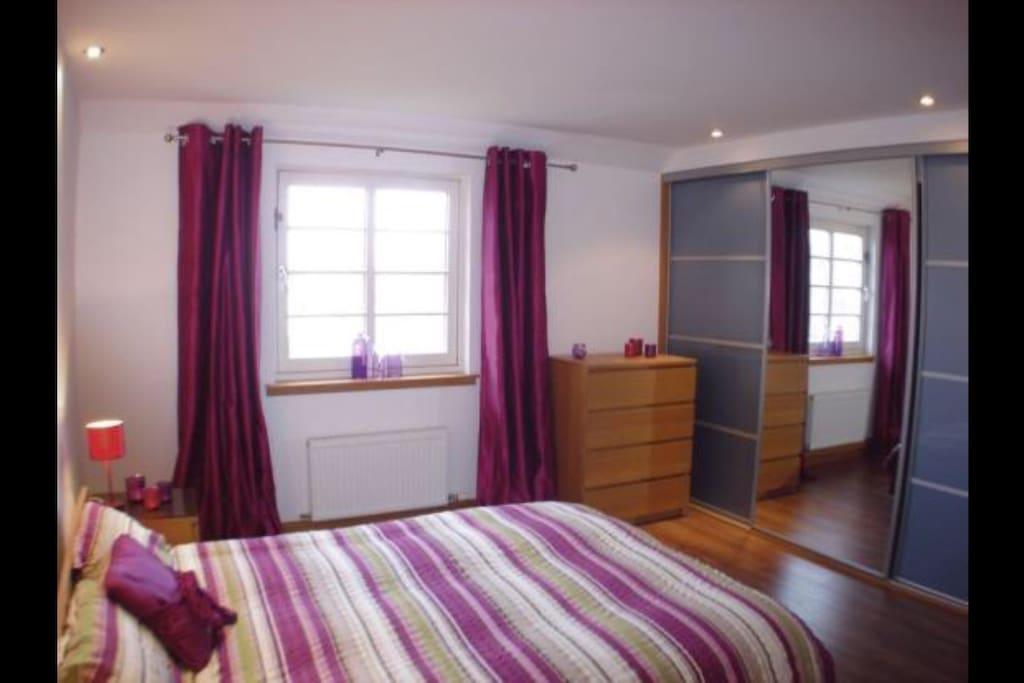 top floor bed room with walk in wardrobe, shower un-suit